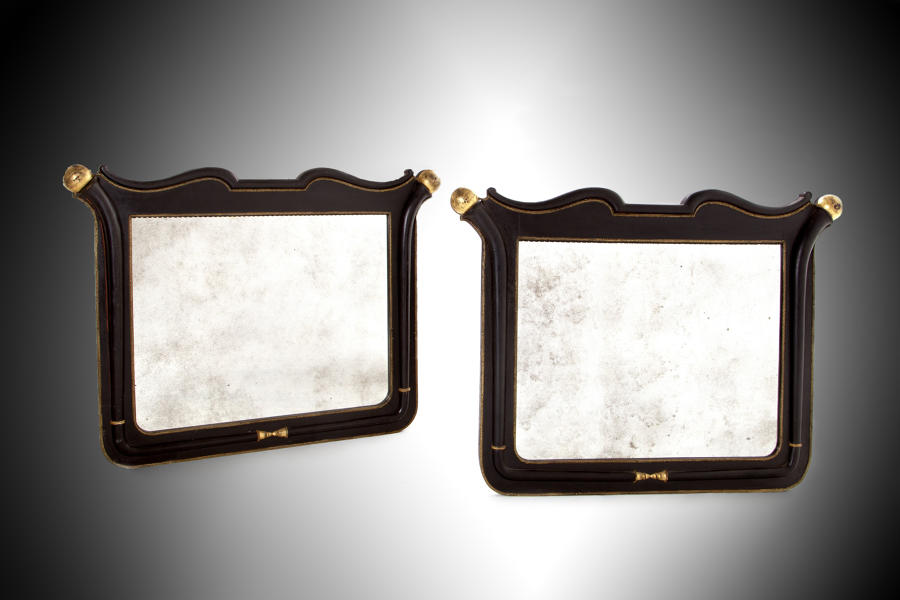 A pair of 19th century black and gold overmantel mirrors