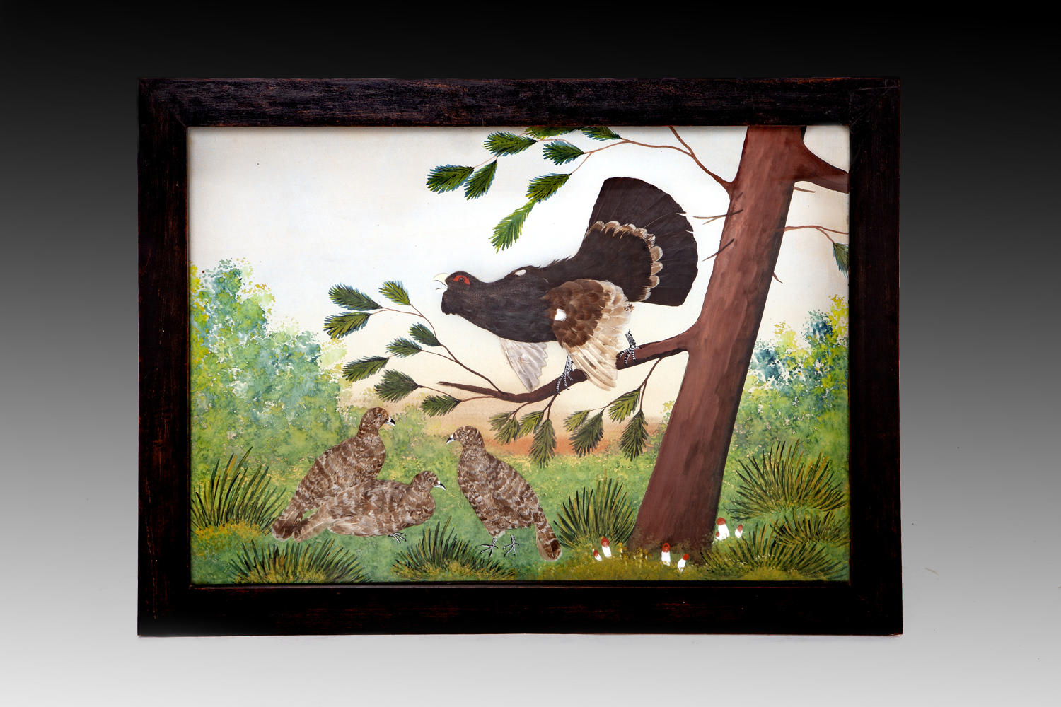 A featherwork picture of a Capercaille in a natural landscape