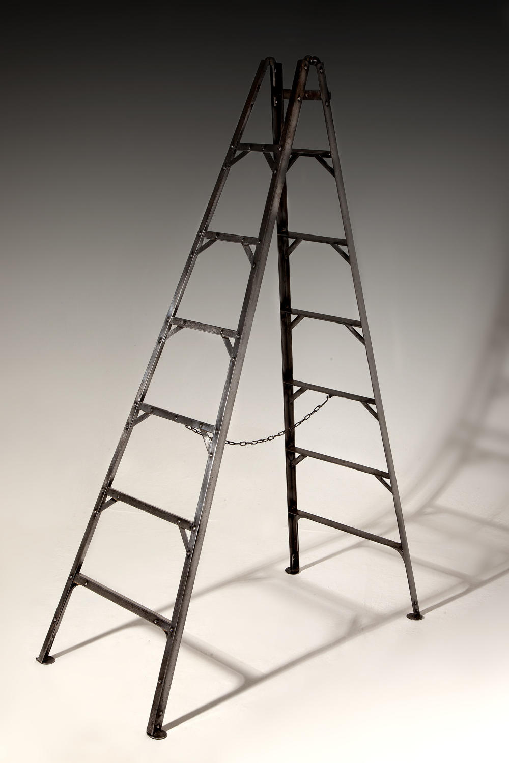A rare set of early 19th century pruning/library ladders
