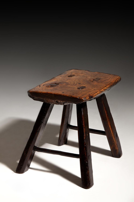 An early 19th century elm wood hearth stool