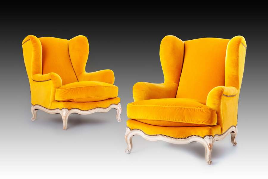 A pair of Maison Jansen Louis XV style armchairs