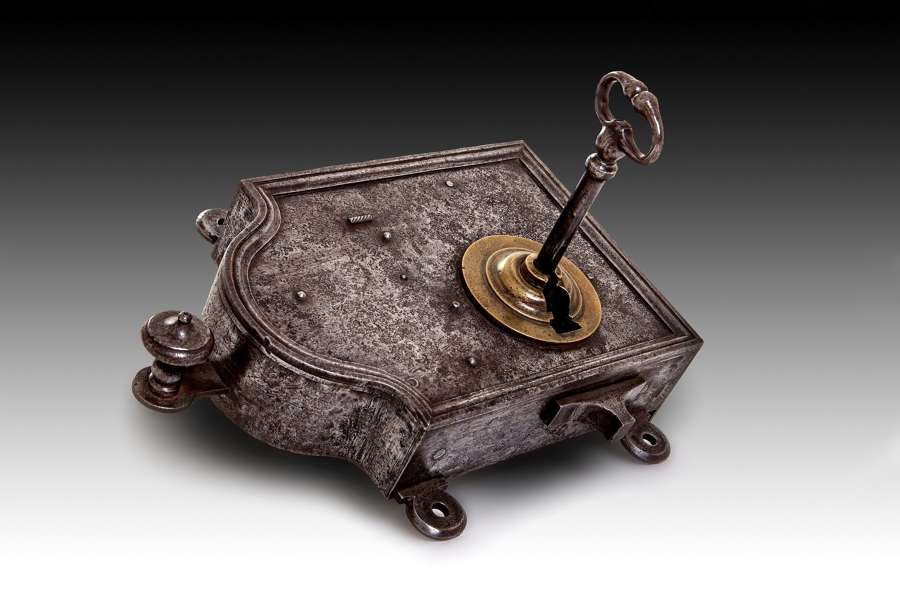 A large 18th century polished steel and brass night lock
